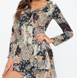BNWT. Long sleeve floral mini dress